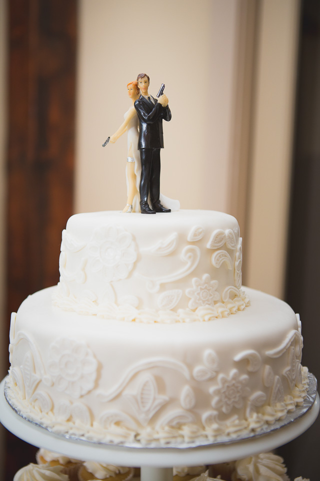 bride and groom with gun cake topper