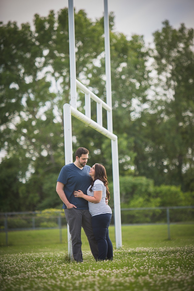 engagement photography at football field