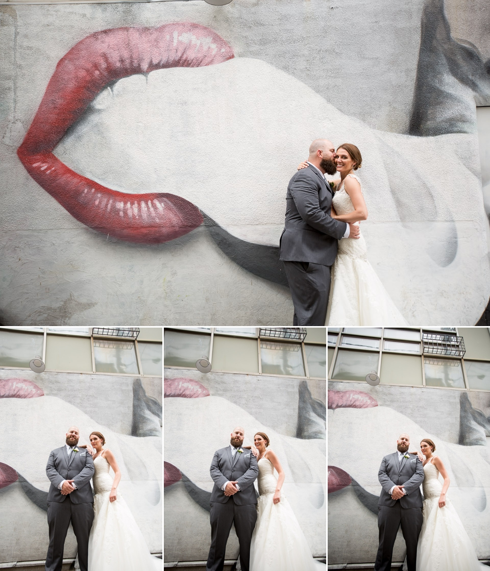 bride and groom in front of graphiti wall